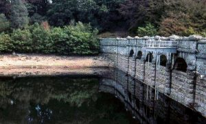 Burrator Dam, Devon, during the during the drought of summer 1976 (low water level)