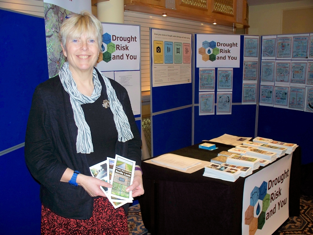 Professor Lindsay McEwen of UWE at the About Drought Showcase in March 2018, standing by the Drought Risk and You (DRY) project stand